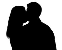 Kissing couple silhouette witn clipping path. Kissing woman and man silhouettes with clipping path Royalty Free Stock Photography