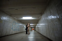 Kissing couple in a subway Royalty Free Stock Images