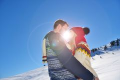Kissing couple under the sun in the Austrian Alps mountains. Stock Photography