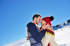Kissing couple under the sun in the Austrian Alps mountains. Stock Images