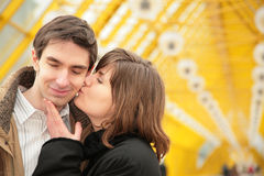 Kissing couple on yellow bridge Royalty Free Stock Photography