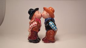 Kissing cowgirl and cowbow salt and pepper shakers Stock Images