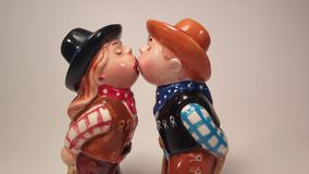 Kissing cowgirl and cowbow salt and pepper shakers Royalty Free Stock Photo