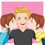 Kissing Dad. Son and daughter kissing happy father cheeks from both sides Royalty Free Stock Photos