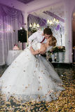 Kissing and dancing young bride and groom Stock Photo