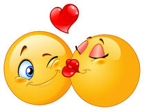 Kissing emoticons Stock Image