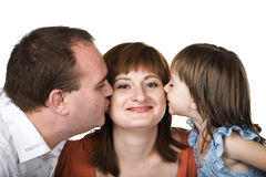 Kissing family Royalty Free Stock Image