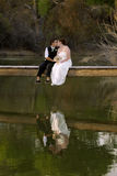 Kissing Female Couple at Lake Stock Photo