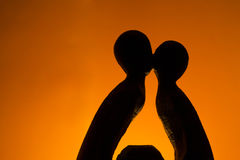 Kissing figurine. Kissing the statue on the background stock photo