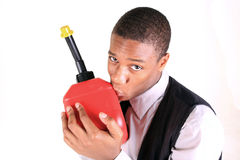 Kissing Gas. A man kissing a gas can Stock Photo