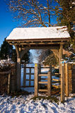 Kissing gate on a bright winter afternoon Stock Photo