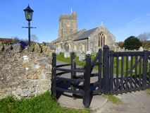 Village church and kissing gate. The kissing gate and church of Saint Mary in the village of Berrow in Somerset, England Stock Photos