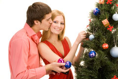 Kissing girlfriend Royalty Free Stock Images