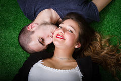 Kissing on grass Stock Photos