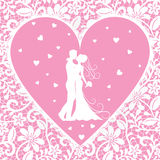 Kissing groom and bride on lace background Royalty Free Stock Images