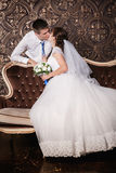 Kissing of the groom and bride in studio Royalty Free Stock Photography
