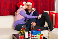 Kissing happy Christmas couple Stock Photos