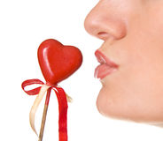 Kissing the heart Stock Images