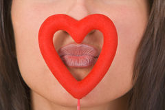 Kissing through the heart Royalty Free Stock Photos