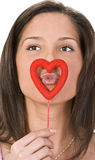 Kissing through a heart Royalty Free Stock Images