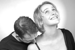 Kissing her shoulder Stock Photos