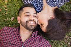 Kissing him in the cheek Royalty Free Stock Images