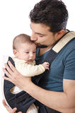 Kissing his daughter. The father kiss and the baby, isolated on white Stock Images