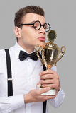 Kissing his trophy. Stock Photo
