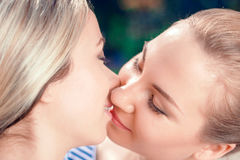 Kissing lesbian couple in park Stock Image