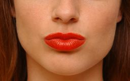 Kissing lips. Young woman making kissing lips Stock Photo