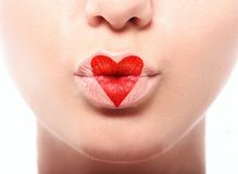 Kissing lips with lovely red make up at the heart Stock Images