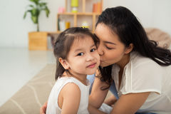 Kissing little daughter Royalty Free Stock Photo