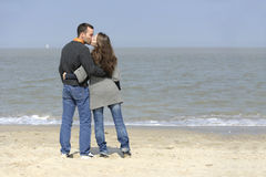 Kissing lovely young couple at the beach Royalty Free Stock Photography