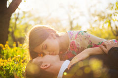 Kissing lovers in the Apple orchard Royalty Free Stock Images