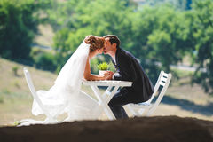 Kissing Man and Woman. Kissing men and women at table Royalty Free Stock Images
