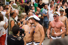 Kissing men at Gay pride parade in Sitges Stock Photo