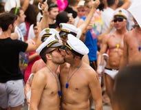 Kissing men   at  Gay pride parade in Sitges Royalty Free Stock Image