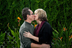 Kissing Middle Aged Couple Stock Photo