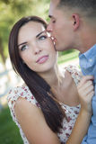 Kissing Mixed Race Couple Portrait in the Park Stock Photos