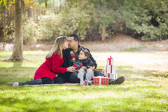 Kissing Mixed Race Family Enjoying Christmas Gifts Royalty Free Stock Photography
