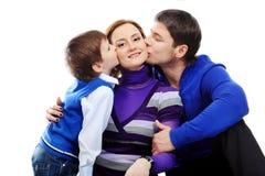 Kissing mom Royalty Free Stock Image