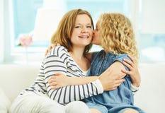 Kissing mom Royalty Free Stock Photo
