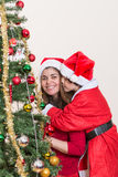 Kissing mom in Christmas Stock Photography