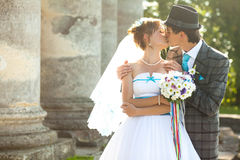 Kissing moment  on the background columns Royalty Free Stock Images