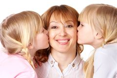 Kissing mother Stock Photos