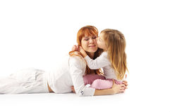 Kissing mother and daughter Stock Photos