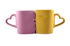 Kissing mugs isolated on white Royalty Free Stock Image