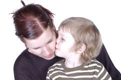 Kissing mum Stock Photography