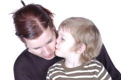Kissing mum. Son kissing his mum Stock Photography