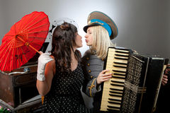 Kissing musicians Royalty Free Stock Photo
